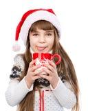 Young girl enjoying big mug of hot drink. isolated on white Royalty Free Stock Photos