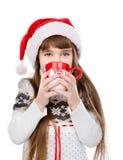 Young girl enjoying big mug of hot drink. isolated on white Stock Image