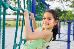 Young girl enjoying the climbing rope stock photo