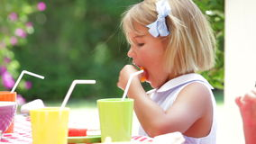 Young Girl Enjoying Food At Party Stock Image