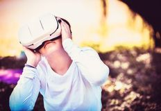 A young girl is enjoying her personal world with a VR headset and a virtual reality. stock photo
