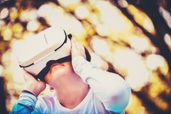 A young girl is enjoying her personal world with a VR headset an stock images