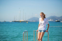 Young girl enjoying her vacation by the sea Stock Photo