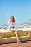 Young girl enjoying her vacation by the sea Stock Photography