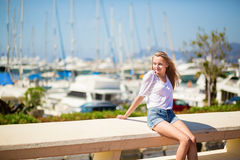 Young girl enjoying her vacation by the sea Stock Image