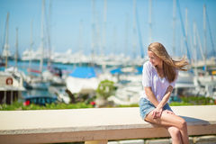 Young girl enjoying her vacation by the sea Royalty Free Stock Photography