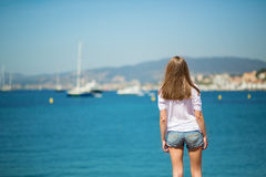 Young girl enjoying her vacation by the sea Royalty Free Stock Photos