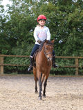 Young Girl Enjoying Horse Riding Stock Photography