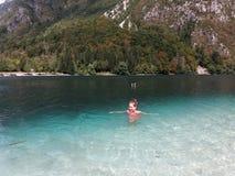 Young girl enjoying in a lake royalty free stock image