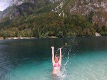 Young girl enjoying in a lake stock image