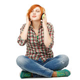 Young girl enjoying listening to music on headphones Isolated on Royalty Free Stock Photos
