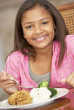 Young Girl Enjoying A Meal At Home Stock Photo