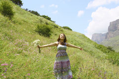 Young girl enjoying the outdoors on a meadow Stock Images