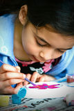 A young girl enjoying painting