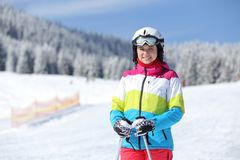 Young girl enjoying skiing on mountain slope. Winter holidays background royalty free stock photos