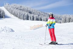 Young girl enjoying skiing on mountain slope. Winter vacation background royalty free stock images