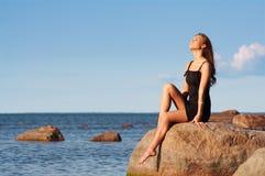 Young girl enjoying the sun Stock Photo