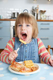Young Girl Enjoying Unhealthy Lunch stock images