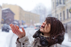 Young girl enjoys the snow on the street Royalty Free Stock Images