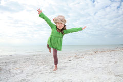 Young girl enjoys summer day at the beach. Stock Image