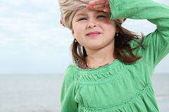 Young girl enjoys summer day at the beach. Royalty Free Stock Images