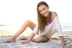 Young girl enjoys summer day at the beach. Stock Photography