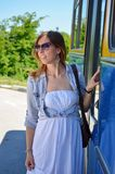 Young girl entering a bus Royalty Free Stock Image