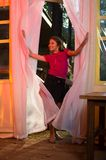 Young girl entering dancing summer pavilion Royalty Free Stock Images