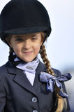 Young girl in equestrian outfit Stock Photo