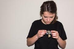 Young girl examinating a damaged electric socket Royalty Free Stock Photos