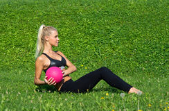 Young girl excersize outside with ball Stock Photography