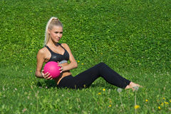 Young girl excersize outside with ball Royalty Free Stock Photos
