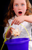Young Girl Excited at Finding Seashell Stock Image