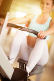 Young girl exercise at the gym Royalty Free Stock Images