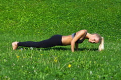 Young girl exercise push ups Royalty Free Stock Photo