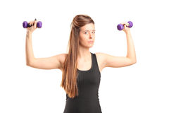 Young girl exercising with dumbbells Stock Images