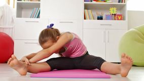 Young girl exercising at home