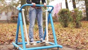 Young girl exercising in urban environment stock video