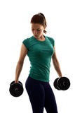 Young girl exercising with weights Royalty Free Stock Photo