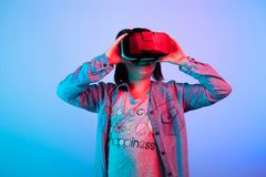 Young girl experiencing virtual reality. With a VR headset on Royalty Free Stock Photos