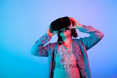 Young girl experiencing virtual reality. With a VR headset on Royalty Free Stock Photo