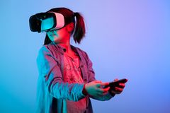 Young girl experiencing VR virtual reality headset. Game Royalty Free Stock Photo