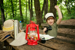 Young girl explores  nature with binoculars on camping trip Royalty Free Stock Images