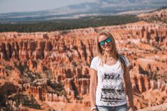 Young girl exploring Beautiful nature. Young girl exploring Bryce Canyon. Hiking down the orange cliffs Royalty Free Stock Photography