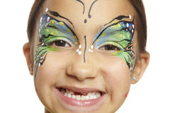 Young girl with face painting butterfly. Smiling on white background royalty free stock images