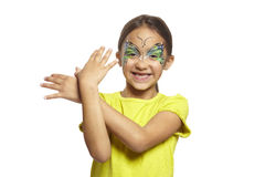 Young girl with face painting butterfly. Smiling on white background stock photography