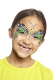 Young girl with face painting butterfly. Smiling on white background royalty free stock photography