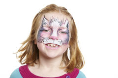 Young girl with face painting cat smiling royalty free stock image