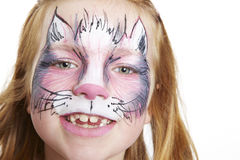 Young girl with face painting cat smiling Stock Image