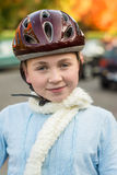 Young girl in fall wearing bicycle helmet. Young girl wearing bicycle hemlet Stock Image
